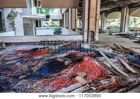 Cables in bandoned hotel in former Tourist Complex of Kupari village Croatia
