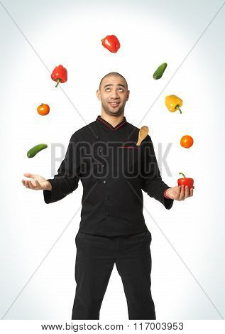 Afro American Professional Cook Juggling Vegetables.