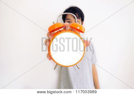 A man showing isolated alarm clock, on white background