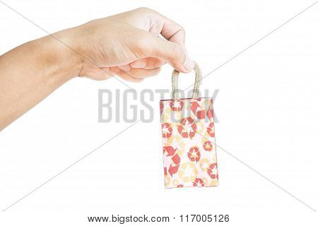 Hand holding little bag recycle paper bag, isolated on white background
