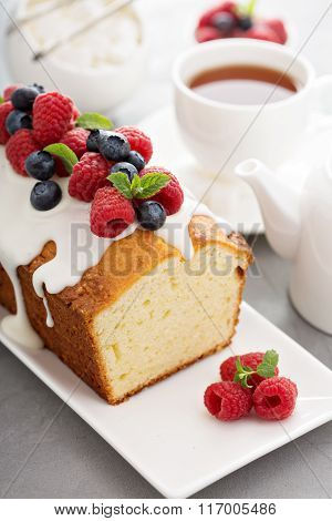 Yogurt pound cake with glaze and fresh berries