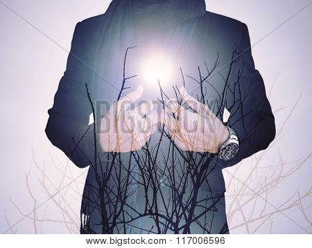 Vintage tone ,double exposure, businessman with dry branches against sun