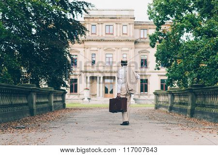 Retro Commercial Traveler Back On His Estate Walking Towards Mansion.