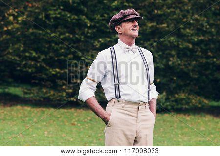 Senior Retro Fashion Man Standing In Garden.