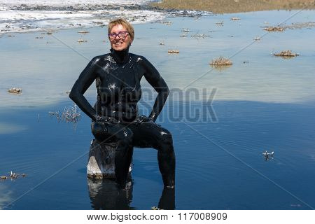 The Woman Accepts The Curative Mud Baths On The Lake Baskunchak.