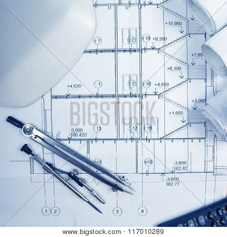 Architectural blueprints, blueprint rolls, compass divider, calc