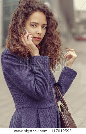 Girl Talking On Cell Phone And She Thoughtfully.