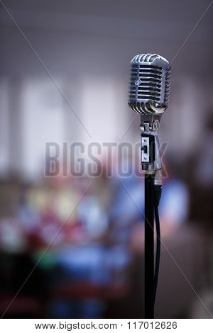 Retro microphone on a blur background