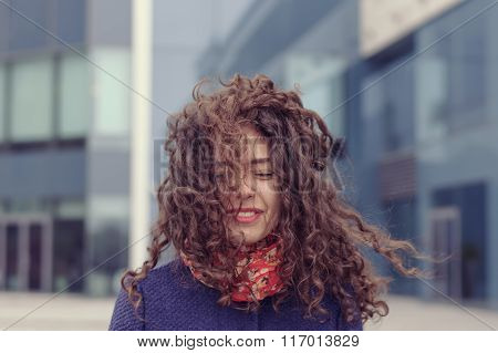 Girl Walking On The Street And The Wind Messed Up Her Hair
