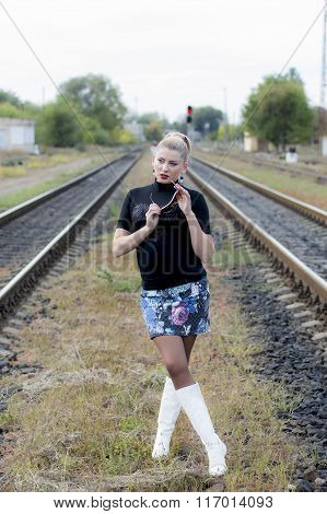 The Sexy Woman Between Two Railway Tracks