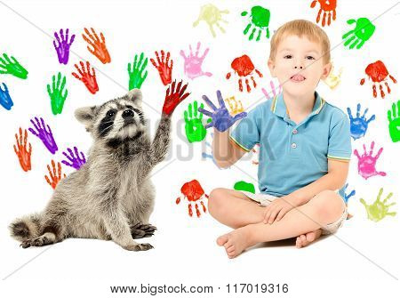 Cute boy with raccoon sitting  on the background of handprints