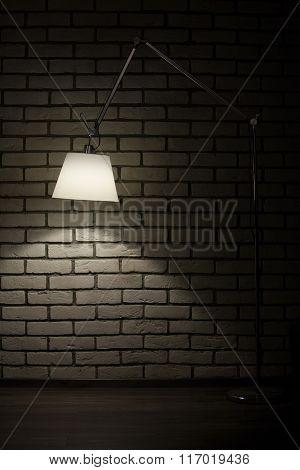 floor lamp in brick room