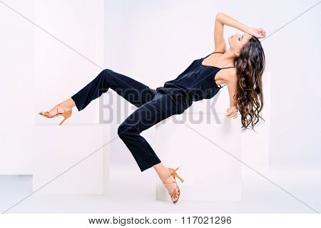 Full length portrait of a beautiful young woman with long brunette hair over white background. Fashion style photo.