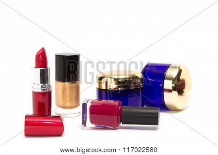 Feminine Cosmetic Background. Essentials Of A Modern Woman In Red And Marsala Colors