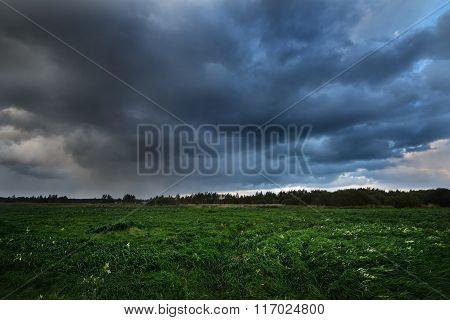Dark Dramatic Rain Clouds Over Countryside Landscape. Autumn In Latvia.