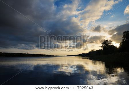 A River And The Dramatic Cloudscape After The Rain In Latvia