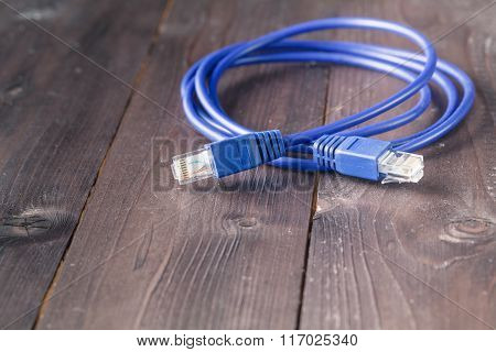 Nternet Blue Cable On Wooden Background