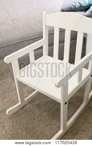 White Rocking Chair In A Living Room