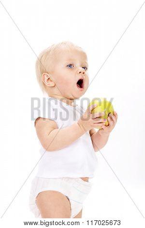 little child baby eating green apple isolated on white background studio shot face fruit
