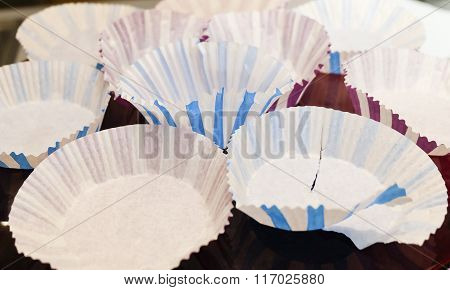 Empty Paper Muffin Cups On A Tray