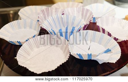 Empty Paper Cupcake Cups On A Tray