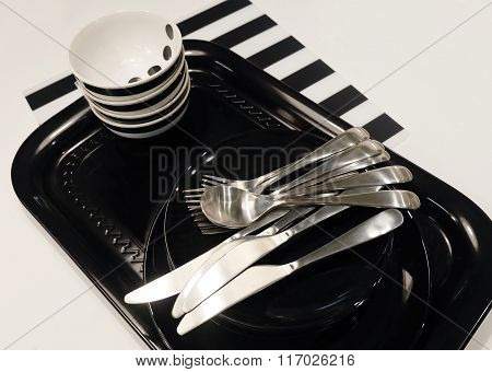 Ceramic Plates, Bowls And Cutlery On Tray