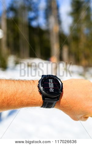 Runner On Mountain Trail Looking At Stopwatch, Activity Tracker