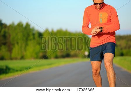 Runner Training And Checking Stopwatch Smart Watch, Cross Country