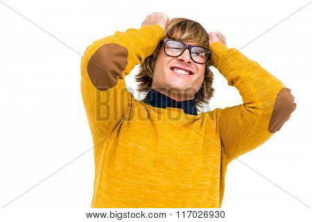 Portrait of angry hipster holding his head on white background