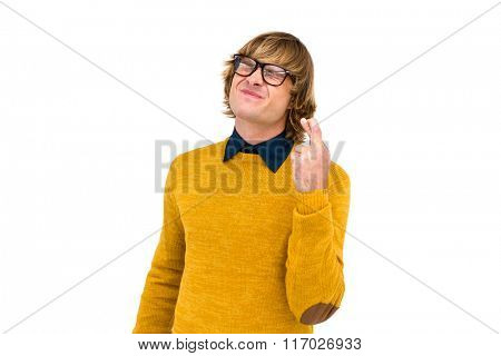 Portrait of hipster crossing his fingers and closing his eyes on white screen