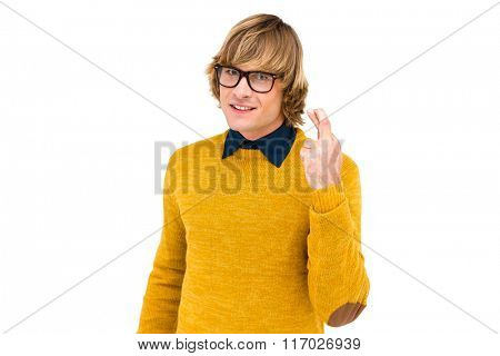 Portrait of hipster crossing his fingers