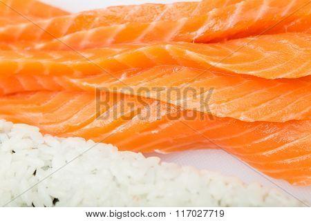 Preparing Sushi Roll, Roll And Salmon Closeup On White Board