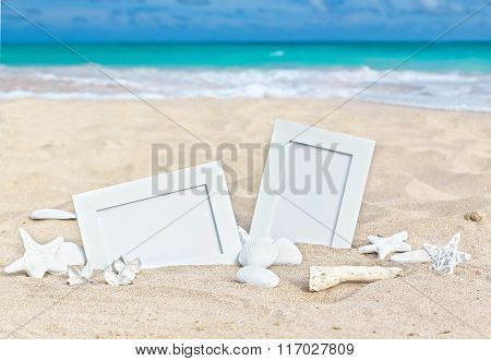 Seascape With Two Photo Frames On The Beach Sand
