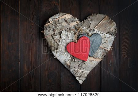 Wooden Hearts On Dark Wood Background
