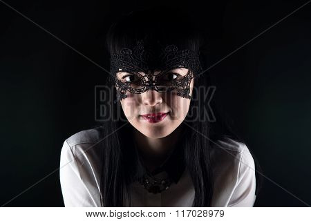 Smiling asian woman and lace mask