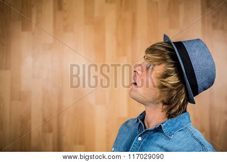 Side view of surprised hipster man looking away