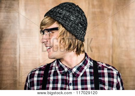 Side view of Happy blond hipster smiling at camera