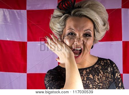 Woman with crown in hysterics