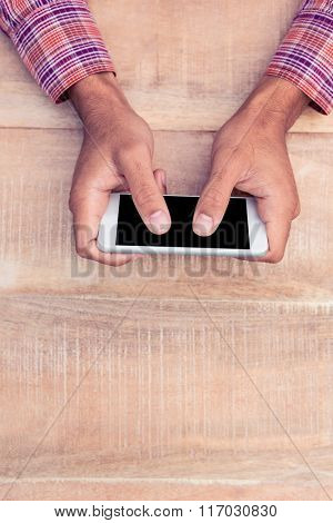 Cropped of man texting message on smart phone