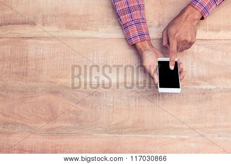 Overhead view of man using of phone over table