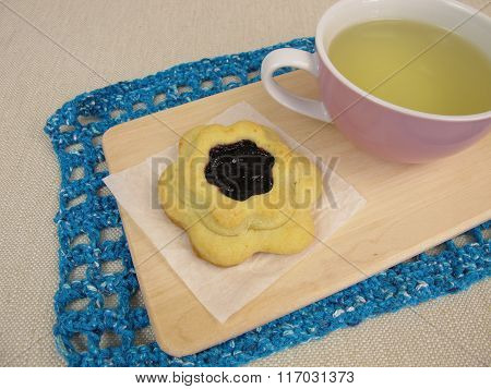 Tea and flower biscuit filled with blueberry jam