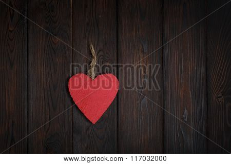 Wooden Heart On Dark Wood Background