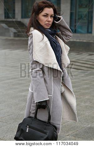 Girl Walking On The Street In Grey Coat