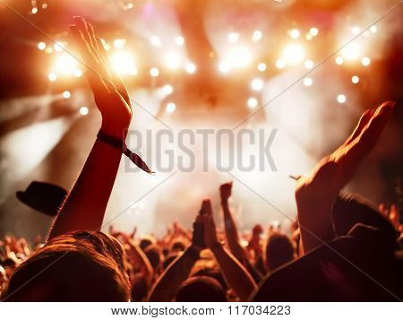 concert crowd clapping at rock concert - slight motion blur of clapping hands