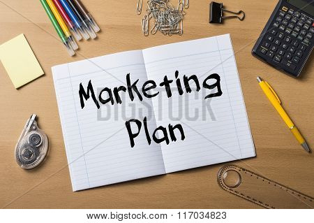Marketing Plan -  Note Pad On Wooden Table