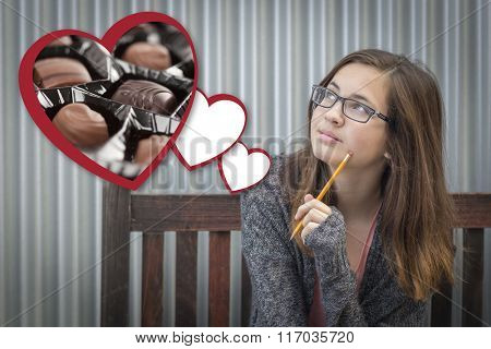Cute Daydreaming Girl Next To Floating Hearts with Chocolates.