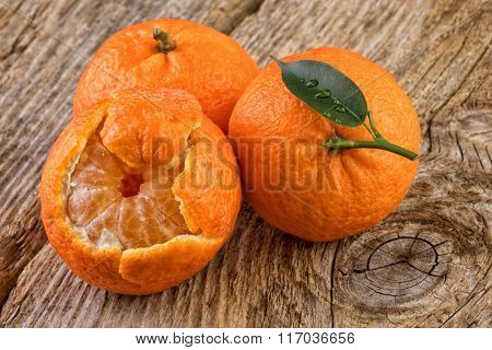 Tangerines Mandarins on Old Wooden Board