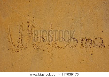 Welcome - Written In Sand On Beach