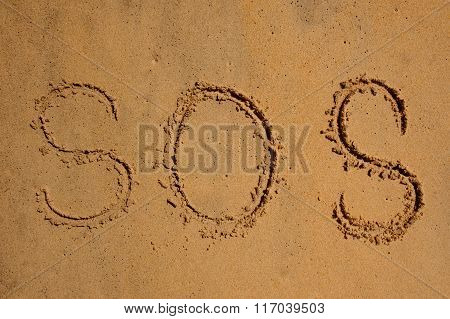 S.o.s Written The Sand With A Finger Or Stick