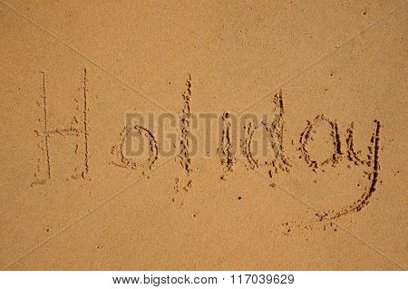 Holiday Sign On The Beach Sand